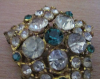 "vintage goldtone brooch 1.75""across with large clear,small clear stones with dark green"