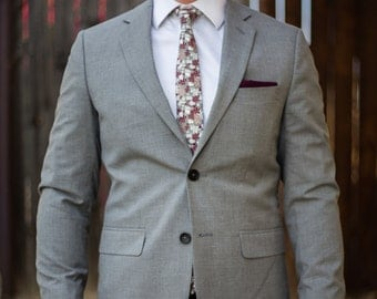 Grey skinny tie with maroon, white, and rose gold floral pattern