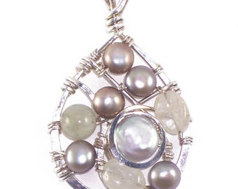 Sterling silver pendant with freshwater pearls and aquamarine