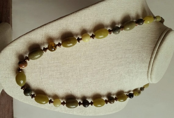 GREEN STONE NECKLACE. Lemon Jade Ovals with Agate, Rhyolite, and Serpentine Rounds, Copper Discs. 23 Inch Single Strand. Copper Clasp.