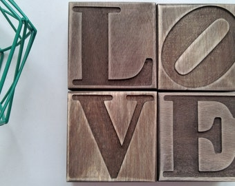 LOVE wooden letters. Decoration of 4 separate modules. Interior design and home style series