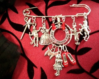 Charm Brooch Wizard of Oz Scarf Pin Theres no place like Home Detailed Dangle Tin man Scarecrow Lion Dorothy Toto Red Slippers Charms