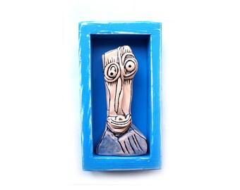 Weird art, Shadowbox art, 3D art sculpture, Creepy doll faces, 3D wall sculpture, Wall shadowbox, Blue shadowbox, Blue scuplture