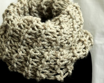 Knitted infinity scarf in beige
