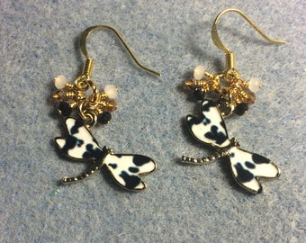 Black and white enamel dragonfly charm earrings adorned with tiny dangling black, white, and amber Chinese crystal beads.