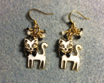White and black enamel and rhinestone cat charm earrings adorned with tiny dangling white and black Chinese crystal beads.