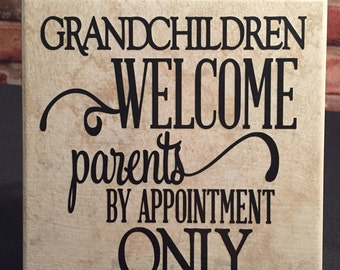 6x6 ceramic tile with stand.  Grandchildren welcome.   Parents by appointment only.   Grandchildren quote.