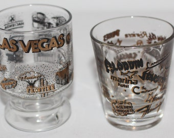 Two Vintage Las Vegas Casinos Shot Glasses Black and Gold Graphics