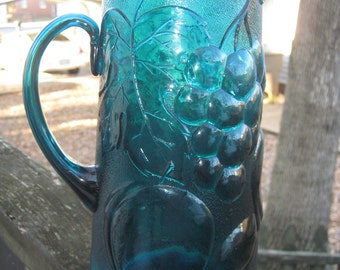 Teal Glass Pitcher, Embossed Fruit Design, Attached Handle, 9 1/4 Inches Tall, Vintage Glassware, Kitchen Serving Piece. Beautiful Color