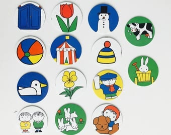 14 cardboard circles with Nijntje / Miffy and other prints made by Dick Bruna