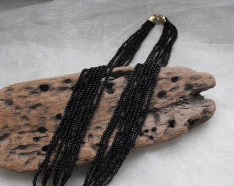 vintage 7 strand black glass necklace made with seed beads