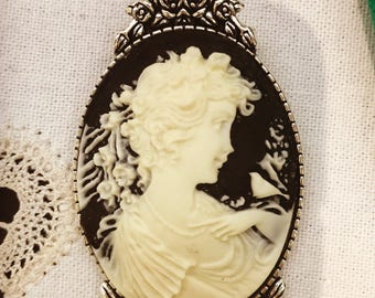 Black Victorian brooch with cameo