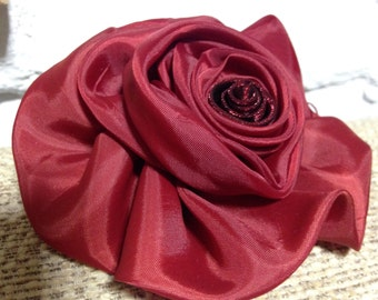 Red silky rose pin