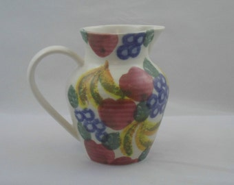Charming porcelain jug or pitcher with bright fruit decoration. Studio pottery jug by former Hornsea pottery designer Ben Thomas