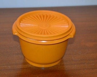 Tupperware solar cover canister, orange