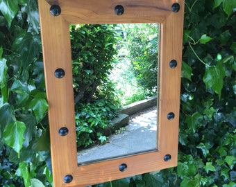 Lovely solid pine portrait mirror with decrotive chain.
