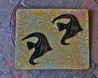 2 fish on brass