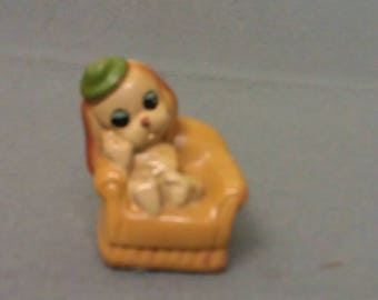 Tan Dog in chair with Green Hat and Blue Eyes Pencil Sharpener