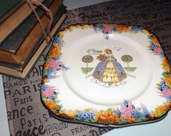 Quite vintage (c.1930s) and VERY RARE! H&K Hollinshead Kirkham Crinoline Lady Square luncheon plate.  Hand-painted, multicolor floral band.