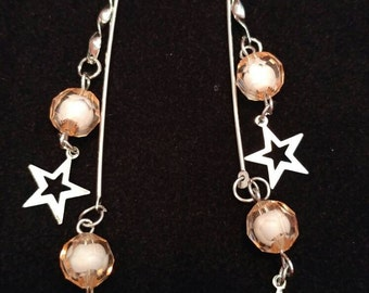 Pretty in pink dangling star earrings