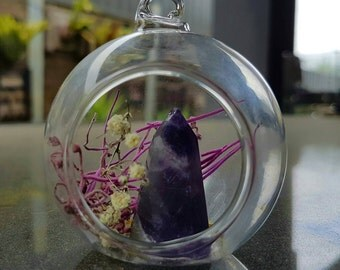 Small glass chamber with amethyst crystal point