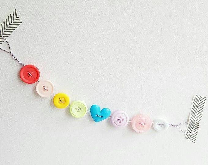 mini pastel rainbow button bunting