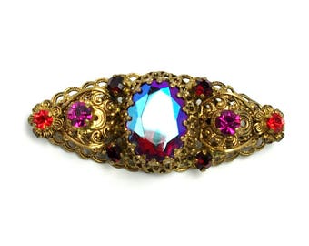"Vintage 1950s Marked 'Made in Germany"" Red, Pink, Orange and Aurora Borealis Rhinestone and Brass Filigree Brooch."