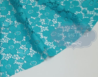 Light blue floral lace fabric.