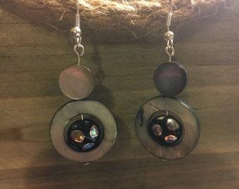 Black disc earrings.