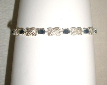 "Sterling silver and semi precious blue stone bracelet. Marked DL with prong set stones. About 7.5"" long and is in very good used condition."