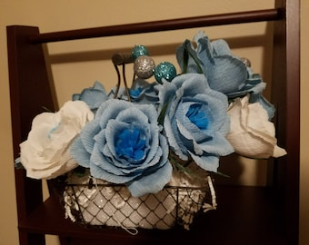 Blue and White Crepe Paper Roses Arrangement in a wire basket