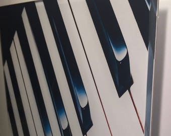 Piano photo face mounted to acrylic.