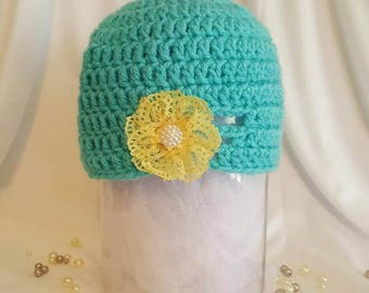 Teal hat with flower