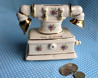 Vintage dainty  telephone money box made by Arthur Wood in the 1960s