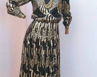 a dark 80's vintage dress with a flash of brillionce sz sm