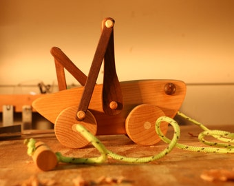 Wooden Toy Grasshopper pull toy, wood grasshopper, wood pull toy. By Bruce Hay.