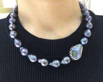 Baroque pearl necklace with beautiful crystal encrusted coin pearl accent.