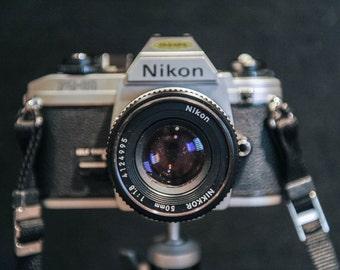 Nikon FG20 35mm SLR Camera with Nikkor 50mm 1:1.8 Lens with strap & vinyl carry case - 1980's