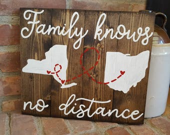 State to state Family knows no distance wood sign