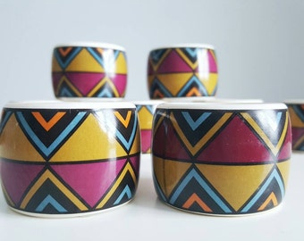 Set of 8 porcelain retro geometric napkin rings