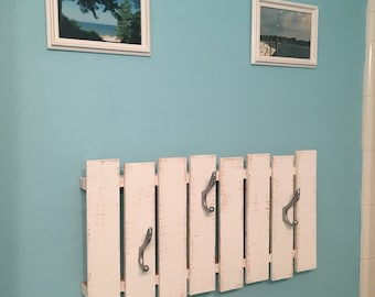 White wooden towel rack