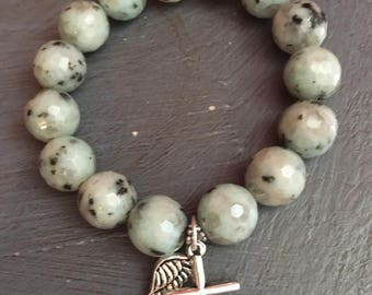 12mm faceted kiwi jasper with silver cross and angel wing