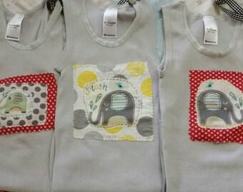 Layered applique elephant  design baby singlets.
