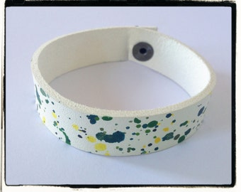 Painted white leather, green and red splash modern bracelets.