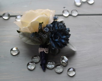 Vintage Cream rose with Navy Pom Pom's and baby's breath Corsage, wrapped in navy blue satin and an accent of chuny pearl lace