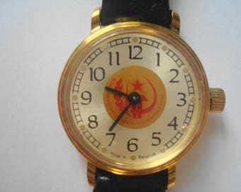 Mechanical wrist watch women's small. The Hammer and sickle.
