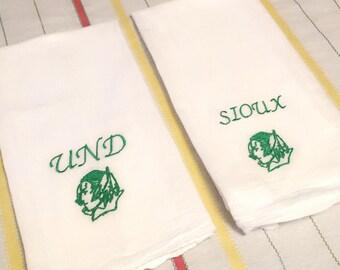4 green on white UND fighting sioux kitchen towels. Flour sack university norh dakota ND