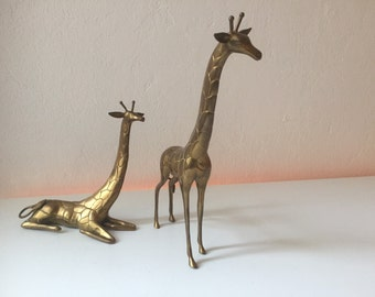 Pair of vintage brass giraffes heavy mid century * giraffe pair of heavy brass *.
