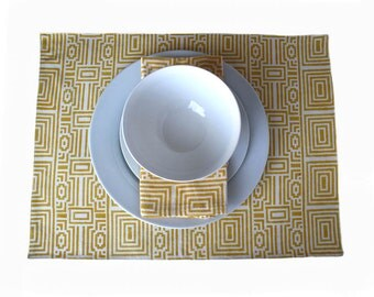 Graphic wood-block printed yellow placemats fully backed with white cotton.