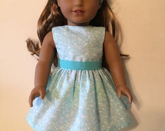White Floral Print on Lt Blue Fabric with Teal Belt and Headband Fits 18 inch Dolls